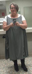 bathroom selfie wearing black and white Madeline slip over a white t-shirt and leggings